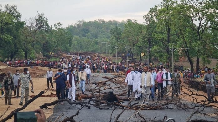 Tribals blocking a road in Silger village as local public representatives take stock of the situation at the protest site. | Photo by special arrangement