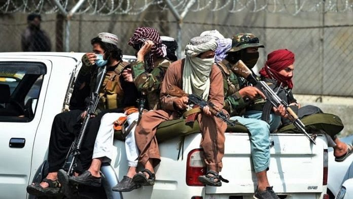Taliban fighters guard outside the airport in Kabul on 31 August 2021   Bloomberg